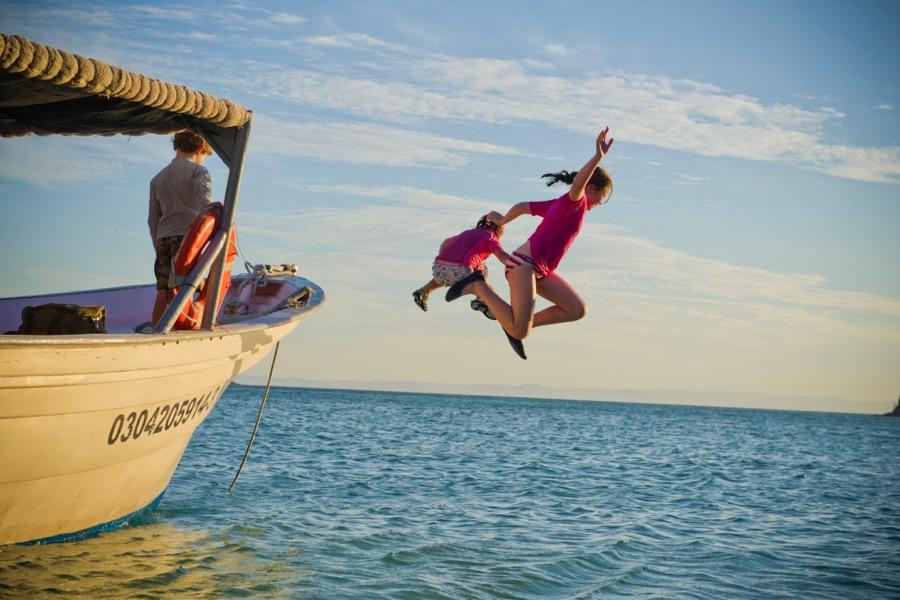 IH kids jumping off boat 9x6