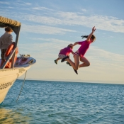 IH kids jumping off boat 9x6