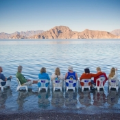 IH people in chairs in water 9x6