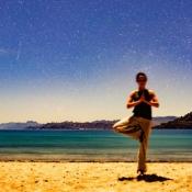 Wellness yoga with stars on beach